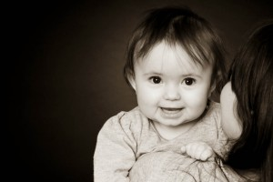 Photo of a baby girl against a dark background