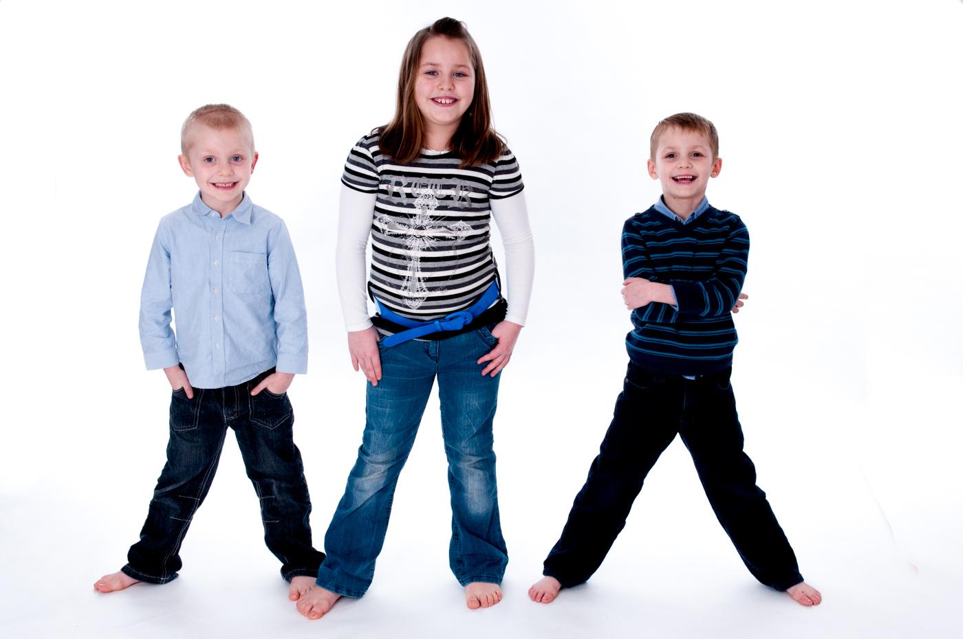 Kids in a row family portraits in Brighton studio